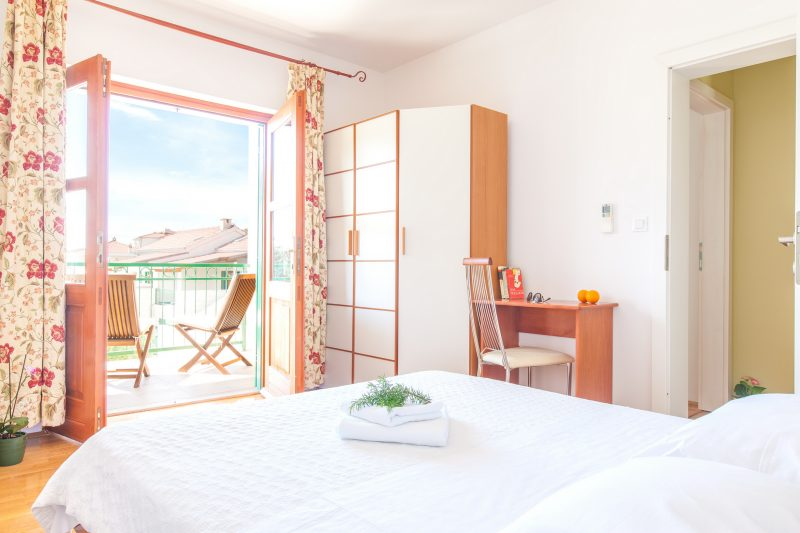 Double bedded room with opened balcony door