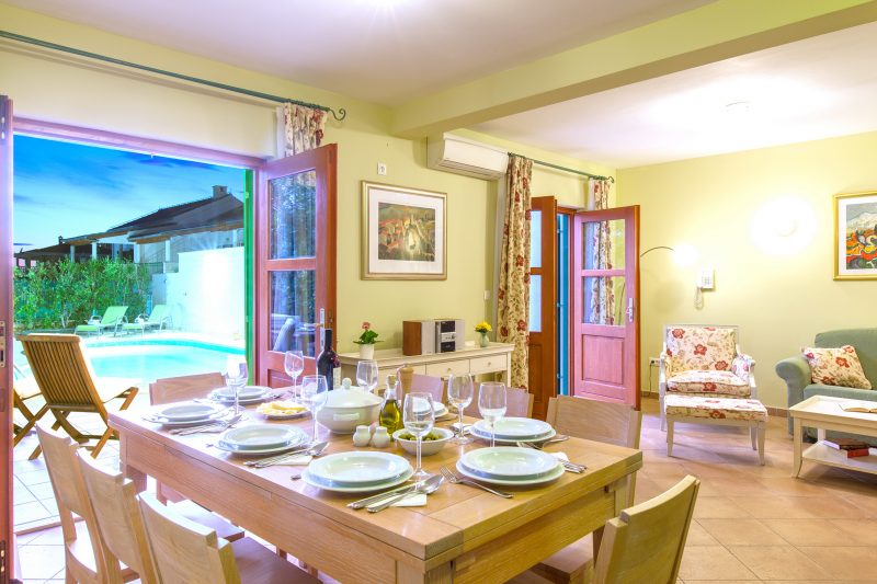 Dining room on the ground floor at Villa Mare with opened French door and the swimming pool view